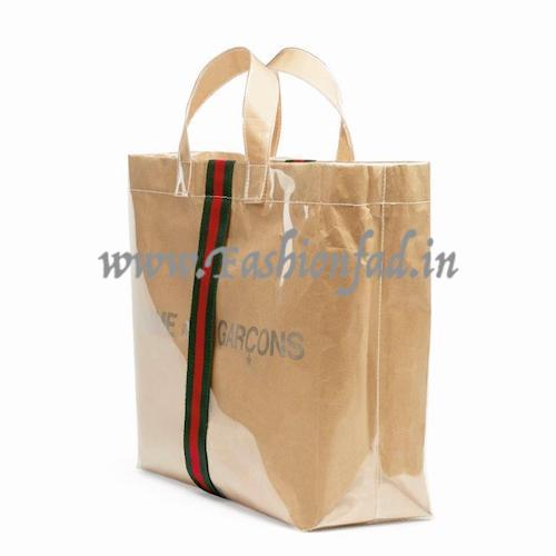 e603521409433c Based on the foundation of a Comme des Garçons shopper this unique piece is  personalised with a Gucci vertical green-red-green Web stripe.